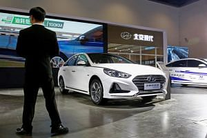 A Sonata hybrid on display at a vehicles expo in Beijing recently. Hyundai Motor says it is closely cooperating with China's BAIC Motor to turn around its China business.