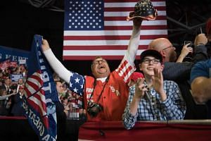 Supporters cheers as US President Donald Trump arrives at a Make America Great Again rally in Cape Girardeau, Missouri on Nov 5, 2018.