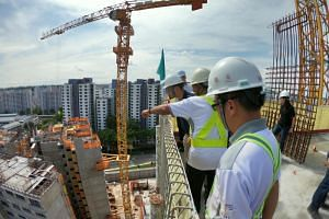 Minister of State for Manpower and National Development Zaqy Mohamad (in blue) visiting a construction site in Bukit Panjang on Nov 7, 2018.