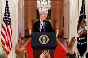 Trump takes questions during a news conference following Tuesday's midterm congressional elections.