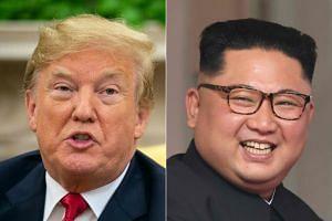 Trump (left) hopes to meet Kim again next year.