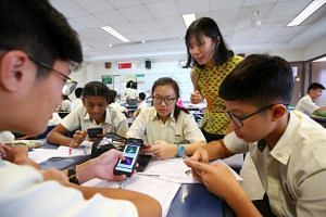 Greendale Secondary School teacher Tan Jie Qi guiding her students while they use the NewsEd app. NewsEd received the silver award for best reader revenue initiative, and the gold award for best innovation to engage youth.