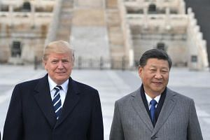 File photo of US President Donald Trump and Chinese President Xi Jinping at the Forbidden City in Beijing, on Nov 8, 2017.