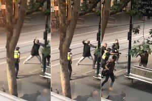 Videos posted to Twitter and broadcast on television showed a man repeatedly swinging an object at two police officers.