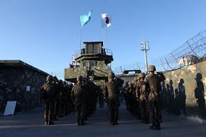A file photo taken on Nov 2, 2018, shows South Korean soldiers saluting before leaving from a guard post in the Demilitarized Zone in Gangwon-do.