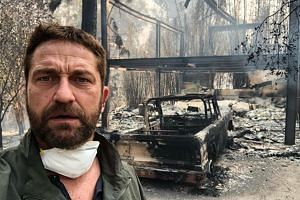 "Gerard Butler said that his home was ""half-gone"" amid footage of smoke rising from the debris, which included the burnt shell of a car."