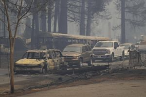 Burned vehicles are abandoned in the aftermath of the wildfires in Paradise, California, on Nov 9, 2018.