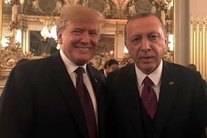 Turkish President Recep Tayyip Erdogan and US President Donald Trump at the official dinner on the eve of the international ceremony for the Centenary of the WWI Armistice of Nov 11,1918 at the Orsay museum in Paris, France, on Nov 11, 2018.