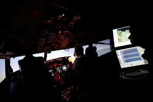 Pilots of Lion Air Group read the checklist as senior pilot supervises during a routine practice session on Boeing 737-900ER simulator at Angkasa Training Center near Jakarta, Indonesia, on Nov 2, 2018.