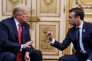 US President Donald Trump with French President Emmanuel Macron in Paris on Nov 10, 2018.