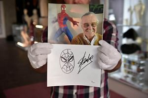 An original sketch by comic book legend Stan Lee of his most iconic creation, Spider-Man, below a portrait of Lee is displayed at Julien's Auctions in Beverly Hills, California, on Nov 13, 2018.