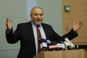 Israeli Defence Minister Avigdor Lieberman (above) said his resignation also withdraws his far-right Israel Beitenu party from Prime Minister Benjamin Netanyahu's conservative coalition government.