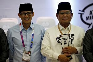 Indonesian presidential candidate Prabowo Subianto (right) with his running mate Sandiaga Uno. Tax reform is one of the key economic programmes that General Prabowo will outline in his election campaign.
