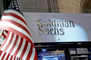 A view of the Goldman Sachs stall on the floor of the New York Stock Exchange. Goldman has two safeguards against law-breaking - one is its structure of accounting and oversight, and the other is its culture, both of which failed in the case of Malay
