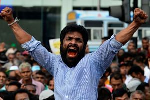 A supporter of Sri Lanka's ousted prime minister Ranil Wickremesinghe shouts slogans at a rally in Colombo.