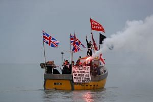 """British fishermen stage a """"Fishing for Leave"""" protest in Hastings, England, in April 2018."""