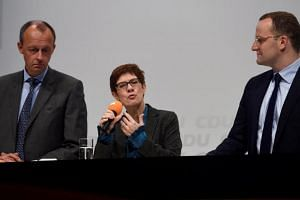 Christian Democratic Union candidates Friedrich Merz, Annegret Kramp-Karrenbauer and Jens Spahn attend a regional conference in Luebeck, Germany, on Nov 15, 2018.