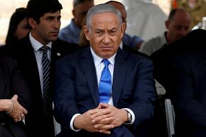 Netanyahu (above) has faced calls from his coalition members to hold a snap election after the resignation of Defence Minister Avigdor Lieberman.