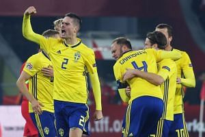 Sweden's players celebrate their win.