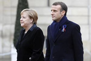 German Chancellor Angela Merkel and French President Emmanuel Macron at the Elysee Palace in Paris on Nov 11, 2018. Dr Merkel recently suggested the idea of an European Union army.