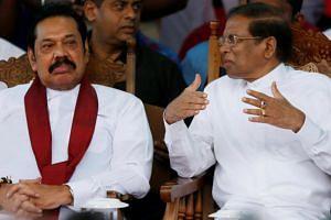 Sri Lankan President Maithripala Sirisena (right) talking with new prime minister Mahinda Rajapaksa at a rally in Colombo on Nov 5, 2018.