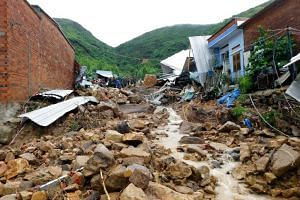 Damaged houses and debris are seen in the aftermath of flash floods and landslides in Phuoc Dong commune in Vietnam's Khanh Hoa province, on Nov 18, 2018.