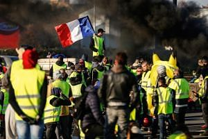People block Caen's circular road on Nov 18, 2018 in Caen, Normandy, on a second day of action, a day after a nationwide popular initiated day of protest called