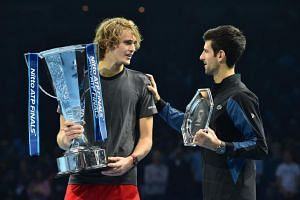 Germany's Alexander Zverev and Serbia's Novak Djokovic with their trophies after the men's singles final match of the ATP World Tour Finals tennis tournament in London on Nov 18, 2018.