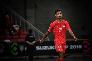 Singapore's Safuwan Baharudin celebrates after scoring his hat-trick and Singapore's sixth goal of the match at the AFF Suzuki Cup on Nov 21, 2018.
