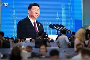 President Xi Jinping speaking at the first China International Import Expo in Shanghai on Nov 5. With alacrity, Mr Xi and top leaders have turned to the only functioning economic engine that China has - its entrepreneurial class, says the writer.