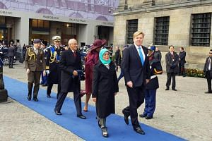 King Willem-Alexander and Queen Maxima formally welcoming President Halimah Yacob and her husband, Mr Mohamed Abdullah Alhabshee.