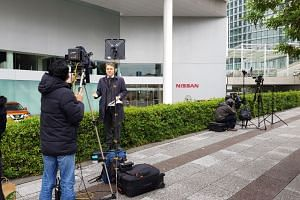 Foreign press outside the Nissan HQ in Yokohama await the board meeting announcement.