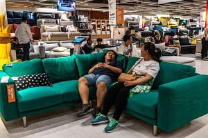 Customers shop for furniture at an Ikea in Beijing, China.
