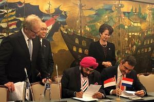 Zener Maritime Solutions' managing director Jagdeep Singh Bhatia and Stolt Tankers' managing director of shipowning Paolo Enoizi signing an MOU yesterday for a partnership on green technologies for shipping. With them are (from left) Confederation of