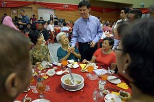 Then Minister for Social And Family Development Chan Chun Sing greeting residents at the annual Chinese New Year dinner for his Tanjong Pagar GRC and the single-seat constituency of Radin Mas on Feb 4, 2014.