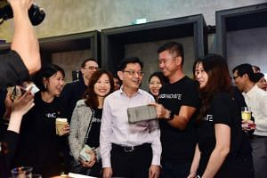 Finance Minister Heng Swee Keat interacting with staff from SGInnovate during the company's second anniversary celebration on Nov 22, 2018.