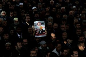 People attend a symbolic funeral prayer for Saudi journalist Jamal Khashoggi at the courtyard of Fatih mosque in Istanbul, Turkey on Nov 16, 2018.