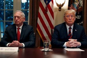 Trump (right) announced in March that he would endorse a plan by Defence Secretary Jim Mattis (left) to restrict the military service of transgender people who experience a condition called gender dysphoria.