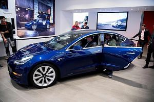 The Tesla Model 3 was expected to compete in the premium sedan market against the likes of Audi and BMW, but owners of mass-market cars are willing to pay for the sedan.