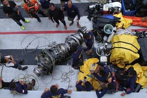 Parts of an engine of the ill-fated Lion Air flight JT 610 are recovered from the sea during search operations in the Java Sea, north of Karawang.