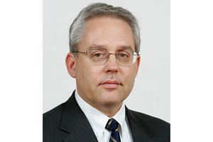 Former Nissan Motor executive Greg Kelly (above) was arrested along with ex-chairman Carlos Ghosn.