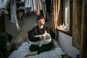 Kim Ji-yeon, one of a growing group of South Korean women rebelling against their society's beauty standards, in her room in Seoul, Nov. 15, 2018.