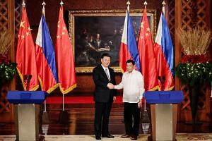 Chinese President Xi Jinping (left) and Philippine President Rodrigo Duterte at the Malacanang Presidential Palace in Manila on Tuesday. The 29 deals signed during Mr Xi's visit were mostly generic MOUs, letters of intent and framework agreements.