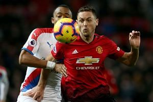 Manchester United's Nemanja Matic (R) in action with Crystal Palace's Jordan Ayew.