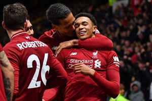 Liverpool's Trent Alexander-Arnold (right) celebrates with Virgil van Dijk after scoring their second goal.