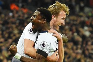 Harry Kane celebrating with Serge Aurier after the Englishman put Tottenham 2-0 up against Chelsea at Wembley on Saturday. The 3-1 loss was Chelsea's first in the league this season, as Spurs moved above them into third place.