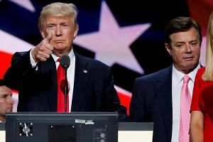 US President Donald Trump with his former campaign manager Paul Manafort during the Republican National Convention in Cleveland, on July 21, 2016.