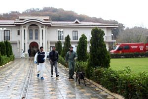 Turkish forencis officers investigate a site at a villa in Yalova city, Turkey, on Nov 26, 2018.