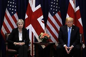 British Prime Minister Theresa May and US President Donald Trump at the United Nations General Assembly in New York on Sept 26. Mr Trump's comments on the Brexit deal have created new difficulties for Mrs May.
