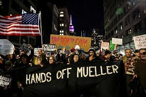 People take part in a protest to protect the investigation led by Special Counsel Robert Mueller, in New York City, on Nov 8, 2018.